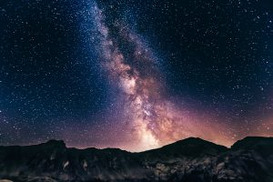 Evening scene with mountains and brilliant sky effects in background. a starry and colorful sky