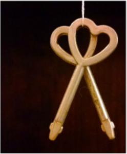 pair of metal keys with hollow hearts at the top