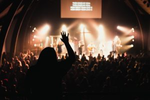 worshippers facing a stage