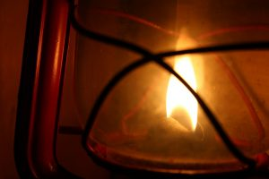 Close up of oil lantern's flame and glass